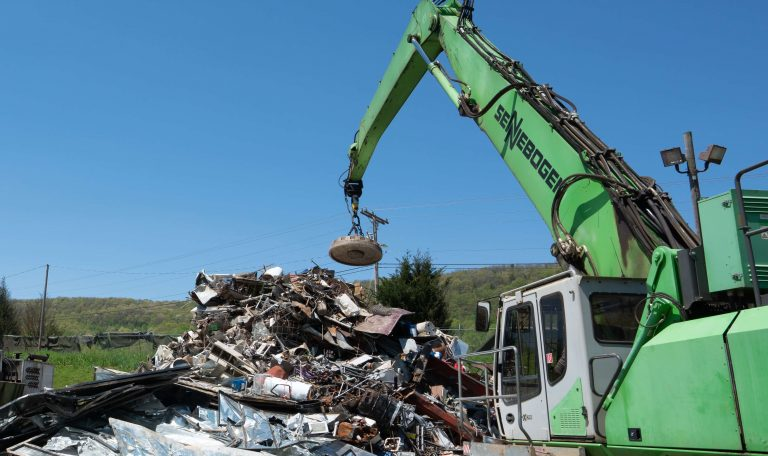scrap metal recycling yard with crane and metal recycling