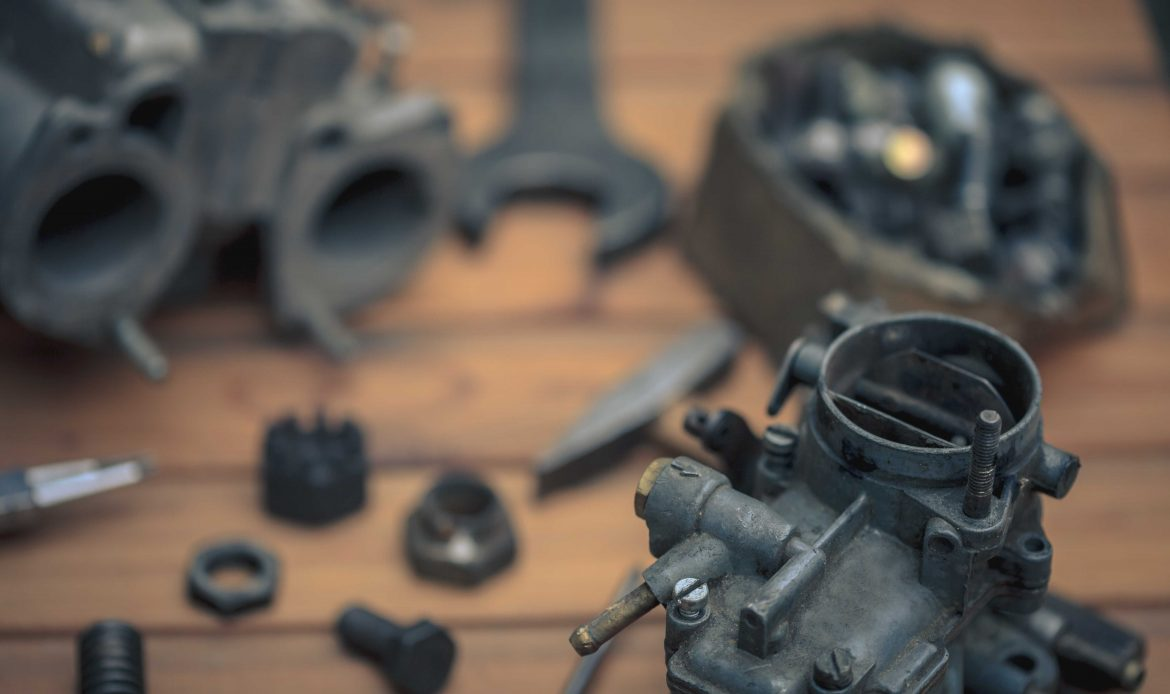 Various car parts and metal pieces that could be scrapped at a scrap metal recycling center near me