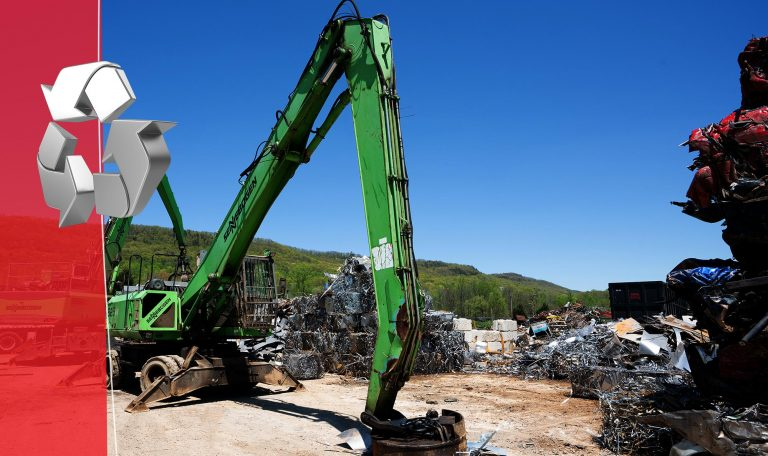 A crane in a scrap metal yard in east tennessee picking up various scrap metals, such as aluminum and steel