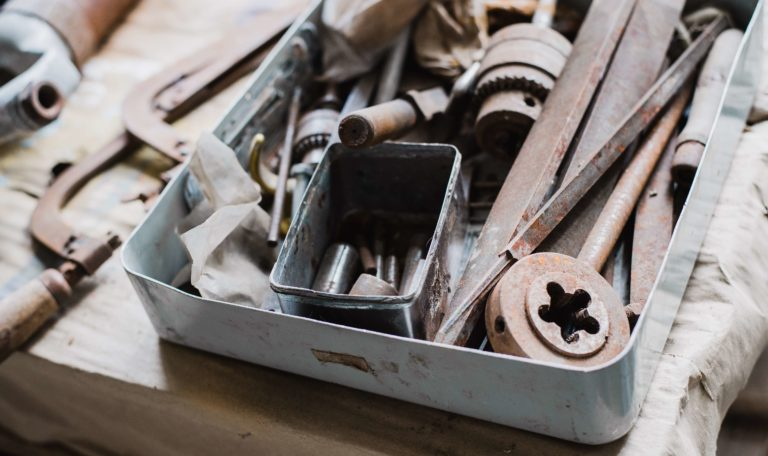 old rusted tools that can be scrapped sitting in a toolbox