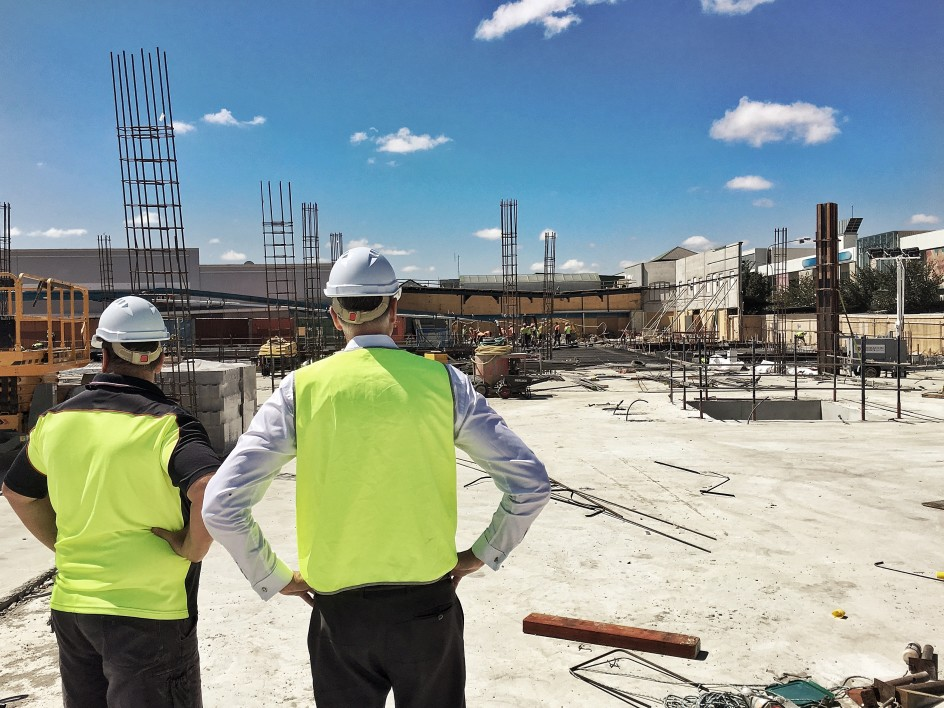two men overlooking a construction site